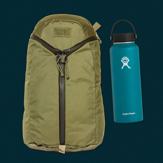 an olive green backpack next to a turquoise water bottle on a dark blue background