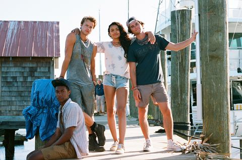 johnathan daviss, rudy pankow, madison bailey, and chase stokes from netflix's outer banks posed together while standing on a dock