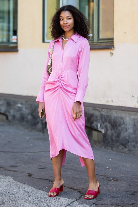 night out outfit including a pink shirt dress and mules