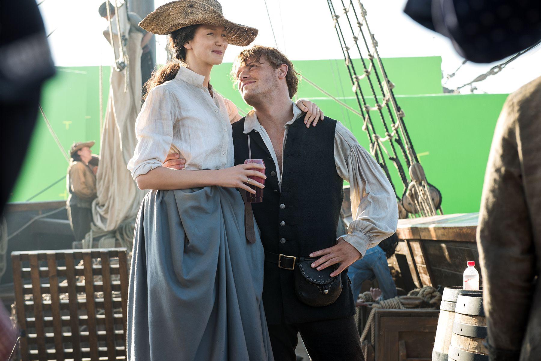 Caitriona Balfe and Sam Heughan on the Outlander set