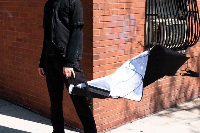 a man holding a flat bag