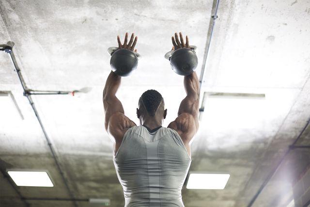 Shoulder, Elbow, Sports uniform, Joint, Standing, Sportswear, Wrist, Ceiling, Muscle, Sleeveless shirt,