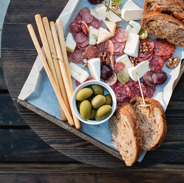 overhead view of antipasto and red wine on a table