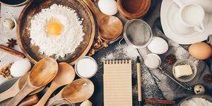 Overhead view of baking ingredients and a notepad