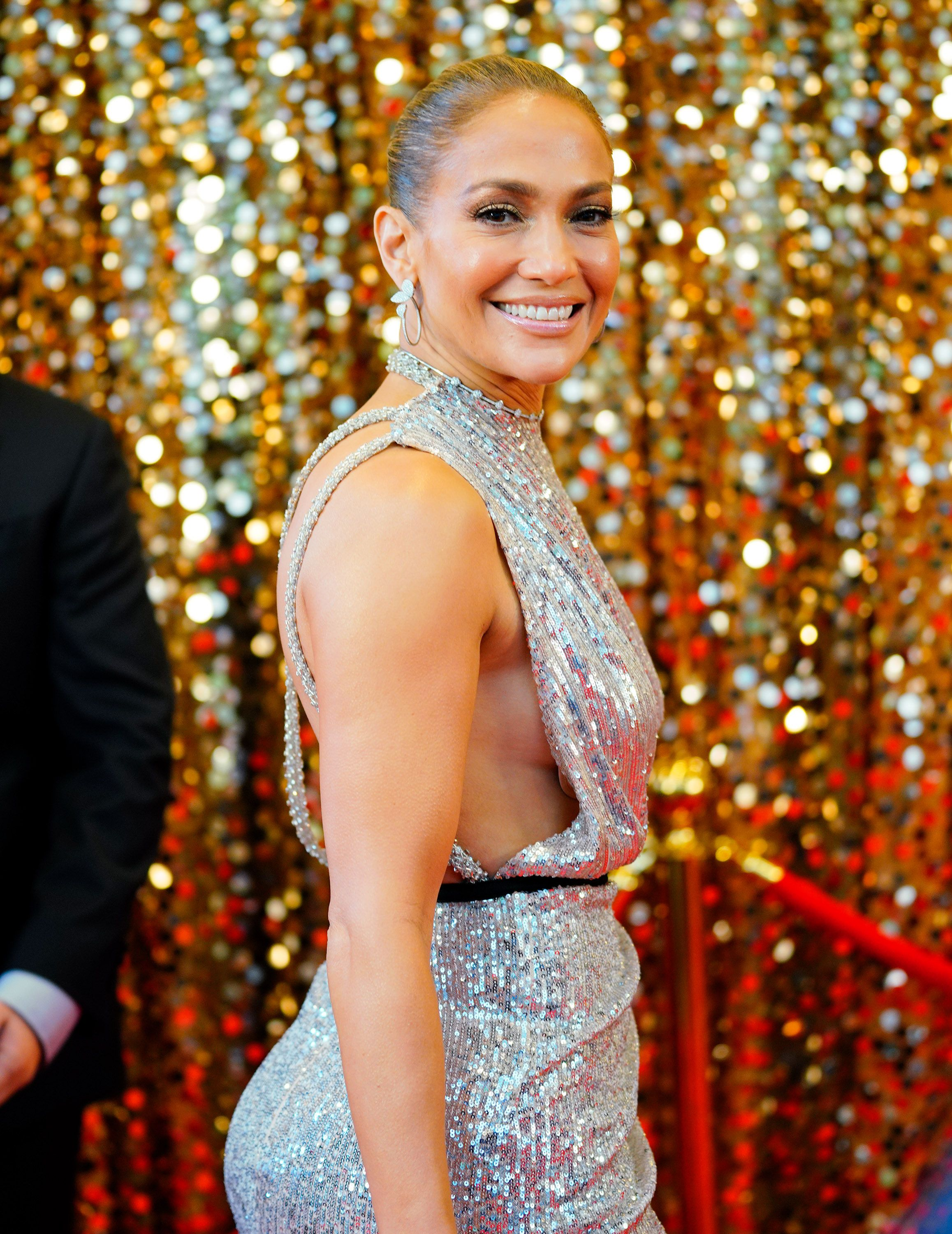 Jennifer Lopez Wore an Over-the-Top Sequined Slit Dress to Work