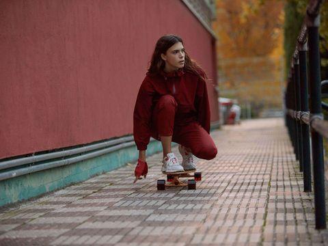 Skateboarder, Skateboard, Longboard, Skateboarding Equipment, Recreation, Fun, Sports equipment, Outerwear, Photography, Sitting,