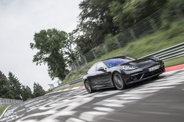 the porsche panamera turbo on the nurburgring race track going fast