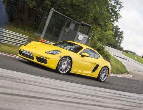 Land vehicle, Vehicle, Car, Sports car, Automotive design, Yellow, Performance car, Coupé, Supercar, Porsche,