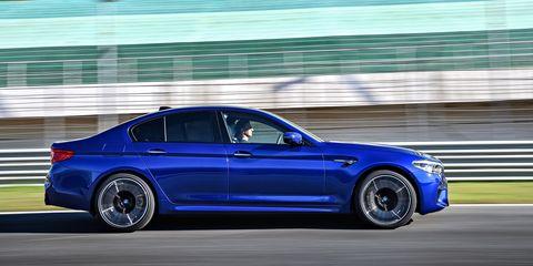 Land vehicle, Vehicle, Car, Luxury vehicle, Personal luxury car, Automotive design, Bmw, Blue, Automotive tire, Tire,