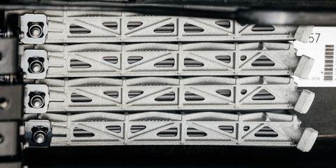 Font, Tire, Pattern, Automotive tire, Grille, Shoe, Metal,