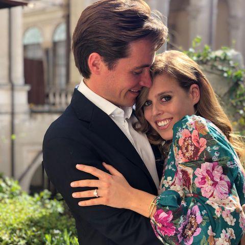 Photograph, Suit, Facial expression, Formal wear, Romance, Smile, Dress, Ceremony, Event, Tuxedo,