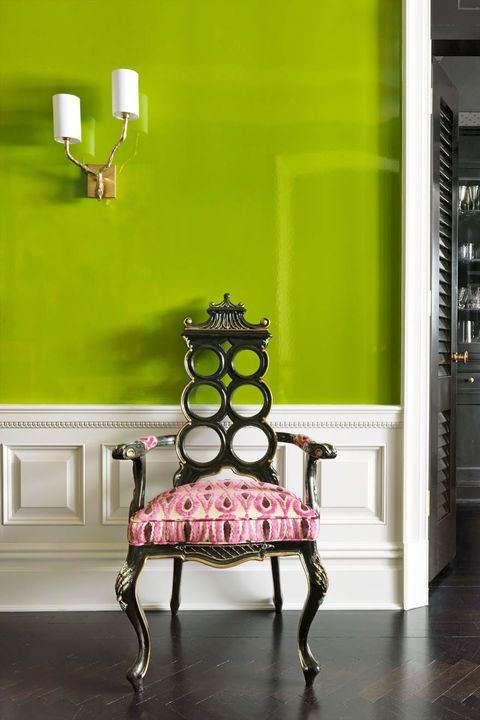 bright green hallway with pink chair
