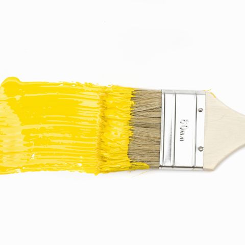 Paintbrush with yellow paint