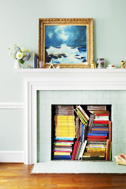 fireplace filled with books
