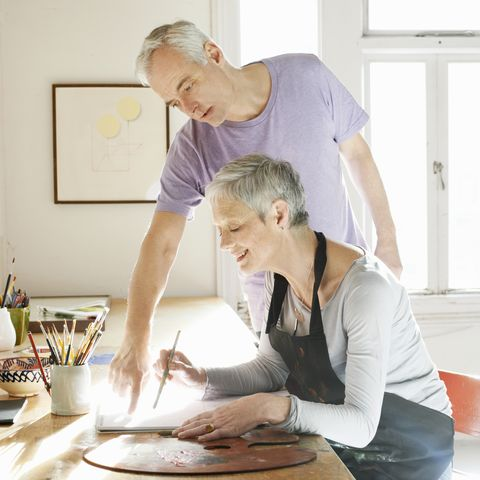 doing a puzzle, painting and playing with pets are top activities to keep your brain healthy at home