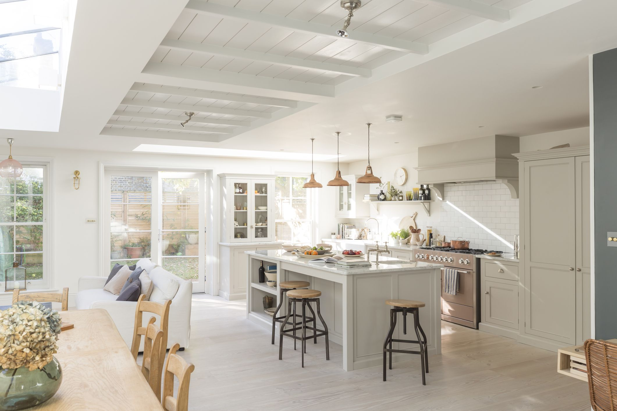 Country Living Magazine & The 10 Best White Kitchen Cabinet Paint Colors for a Clean Airy Vibe