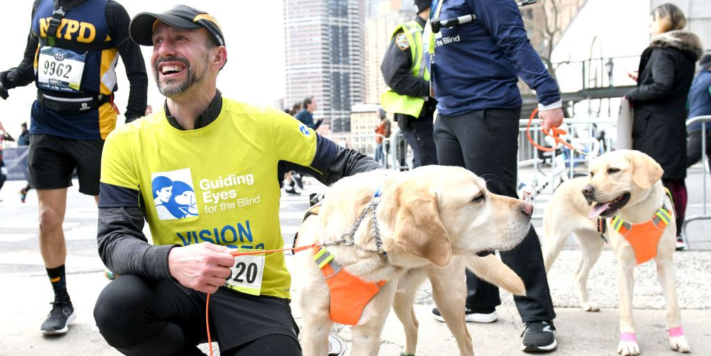 blind runner completes NYC half marathon with guide dogs