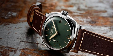 Watch, Analog watch, Watch accessory, Fashion accessory, Strap, Jewellery, Brown, Material property, Brand, Font,