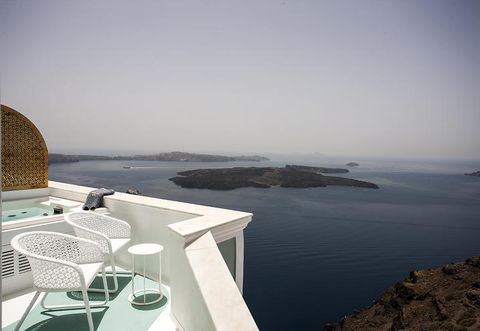 Coastal and oceanic landforms, Coast, Horizon, Sea, Outdoor furniture, Ocean, Island, Bay, Outdoor table, Peninsula,
