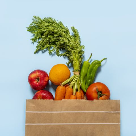 paper bag full of fruits and vegetables