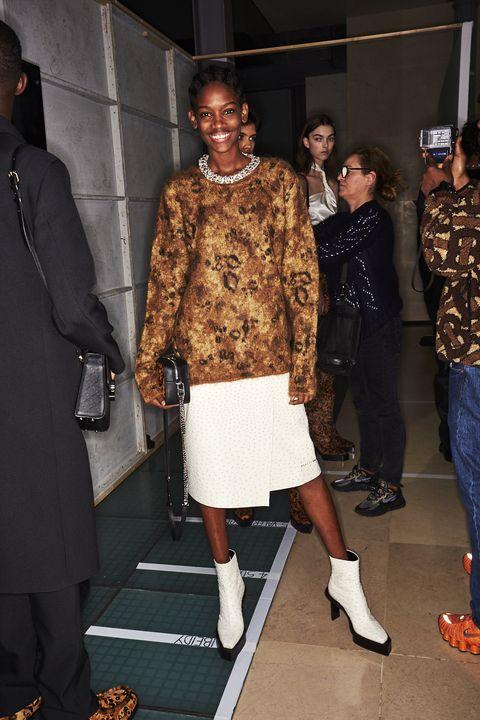 Fashion, Fashion design, Footwear, Event, Outerwear, Leg, Fur, Dress, Haute couture, Shoe,
