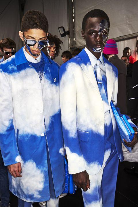 White, Blue, Cobalt blue, Fashion, Eyewear, Suit, Event, Fashion design, Electric blue, Outerwear,