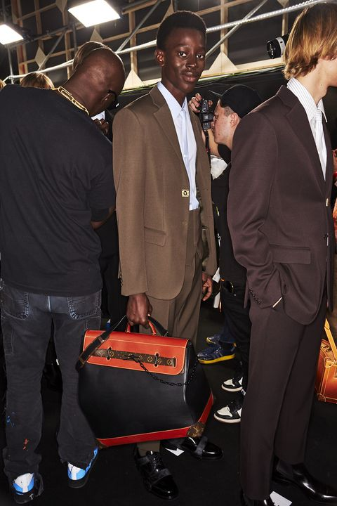 Event, Suit, Fashion, Outerwear, Blazer, Formal wear, Baggage,