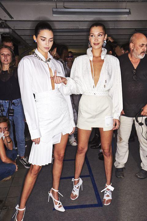 White, Fashion, Footwear, Fashion design, Street fashion, Event, Shoe, Uniform, Eyewear, Fashion model,