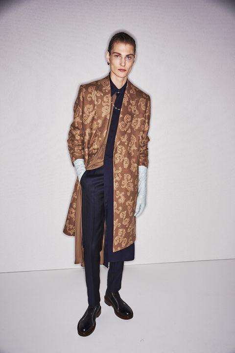 Clothing, Fashion, Suit, Outerwear, Fashion design, Fashion model, Formal wear, Human, Footwear, Blazer,