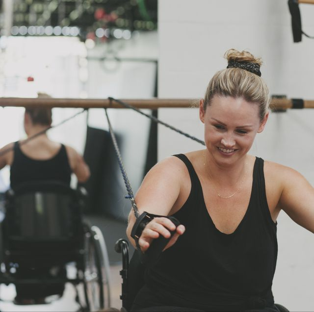 paraplegic woman in a gym