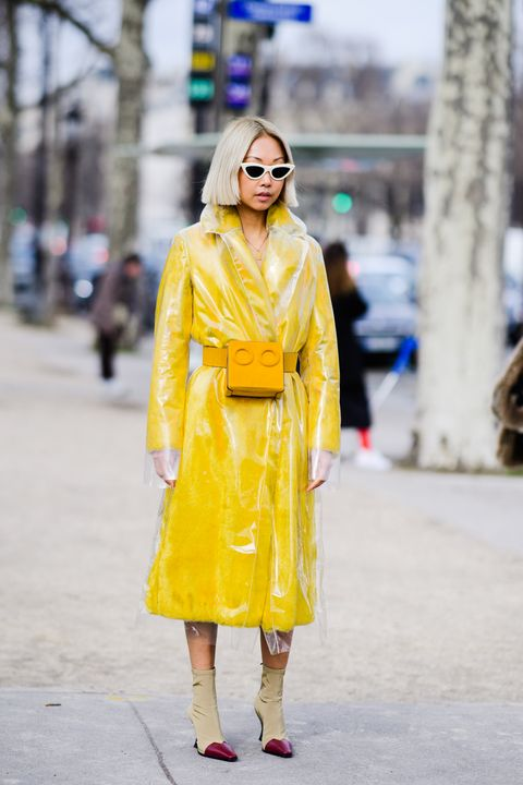 Clothing, Fashion, Street fashion, Yellow, Fashion model, Orange, Coat, Trench coat, Outerwear, Overcoat,
