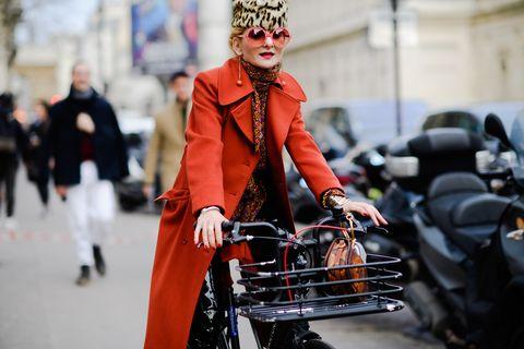 Street fashion, Orange, Fashion, Headgear, Vehicle, Fur, Winter, Coat, Street, Fashion accessory,