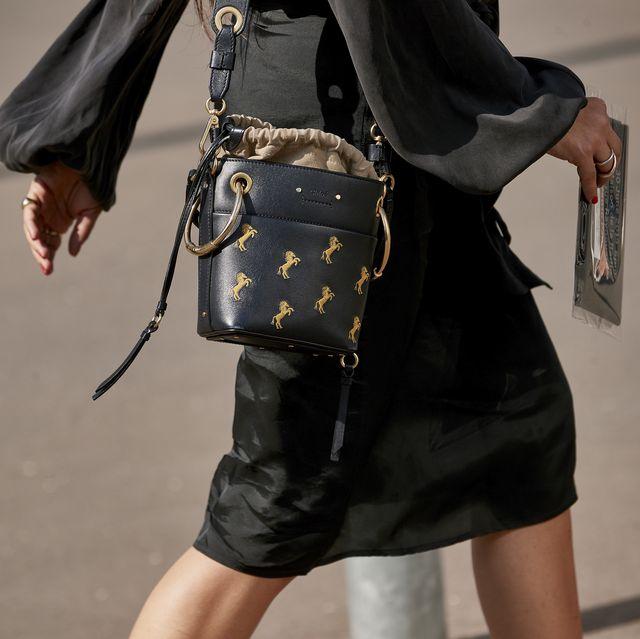 Street fashion, Clothing, Fashion, Leather, Outerwear, Leg, Joint, Shoulder, Human leg, Footwear,