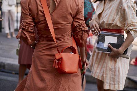 Street fashion, Clothing, Fashion, Orange, Outerwear, Leather, Human, Dress, Footwear, Textile,