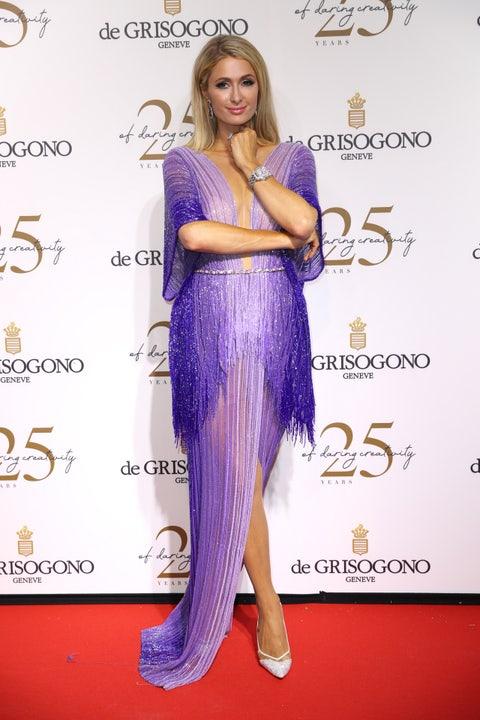 Clothing, Purple, Dress, Hairstyle, Shoulder, Long hair, Fashion, Fashion model, Electric blue, Red carpet,