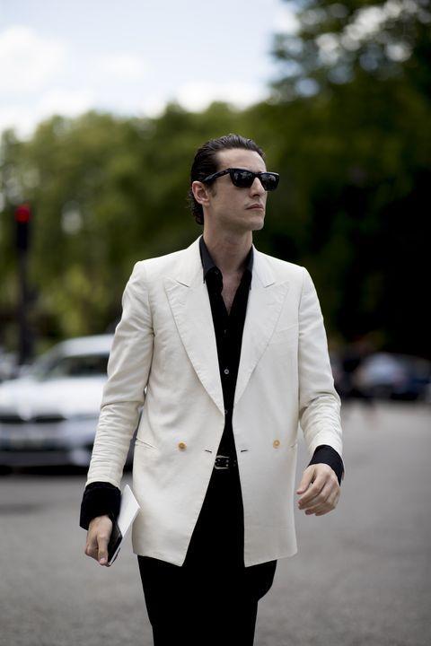 White, Suit, Eyewear, Street fashion, Clothing, Blazer, Fashion, Formal wear, Outerwear, Sunglasses,