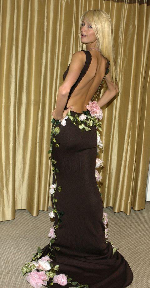 Clothing, Dress, Gown, Shoulder, Fashion, Blond, Haute couture, Formal wear, Fashion model, Waist,
