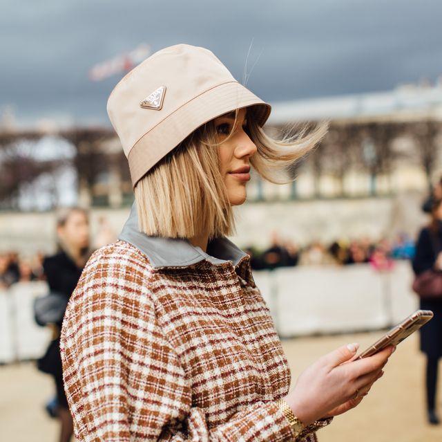 People, Daytime, Yellow, Tourism, Human, Headgear, Fashion accessory, Hat, Travel, Street,