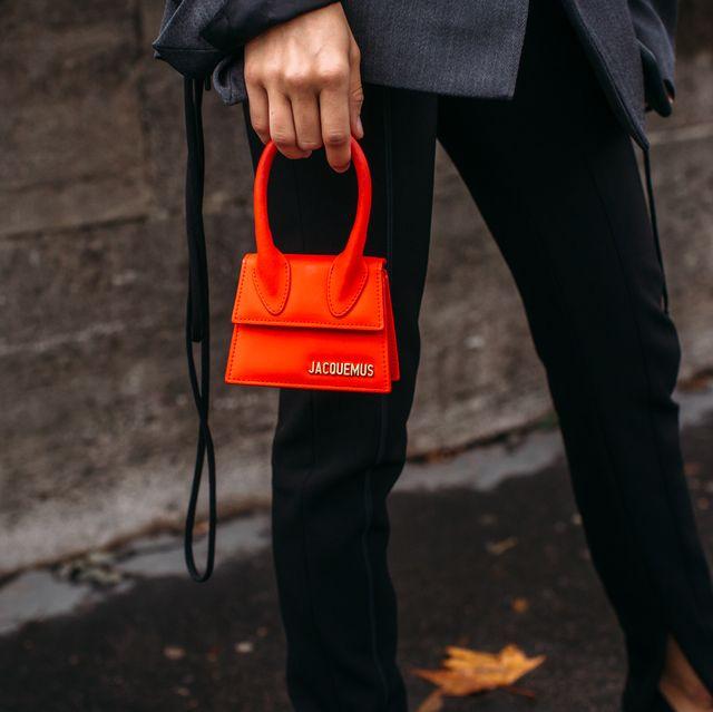 Orange, Red, Standing, Street fashion, Jacket, Outerwear, Tree, Sportswear, Bag, Street,