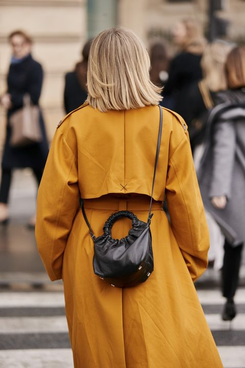 Street fashion, Yellow, Fashion, Clothing, Shoulder, Outerwear, Hairstyle, Blond, Joint, Coat,