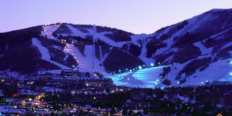 Blue, Mountainous landforms, Mountain, Natural landscape, Sky, Town, Mountain range, Human settlement, Night, Tourism,