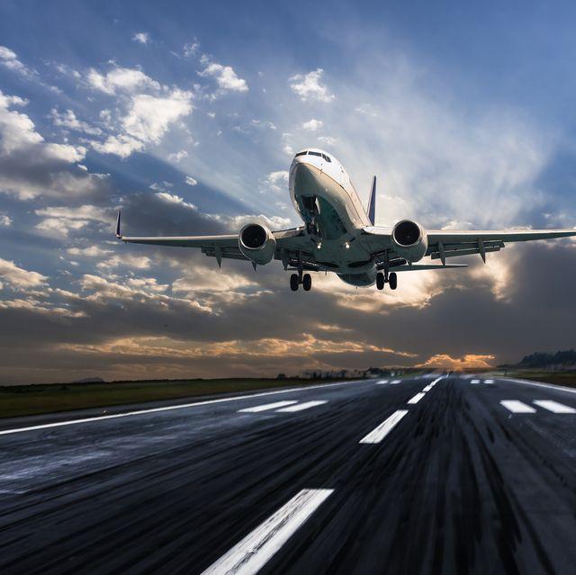 Passenger airplane landing at dusk