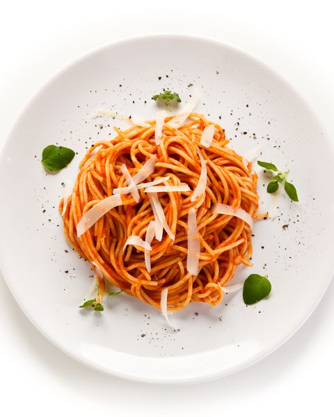 Pasta with meat and vegetables on white background