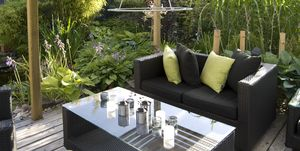 Patio with an outdoor wicker sofa and table