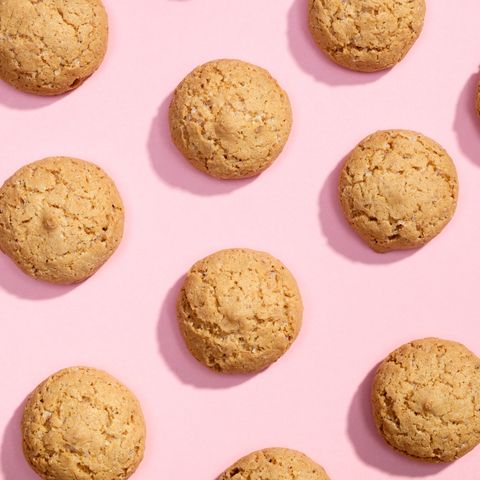 Pattern of sweet cookies on pink background