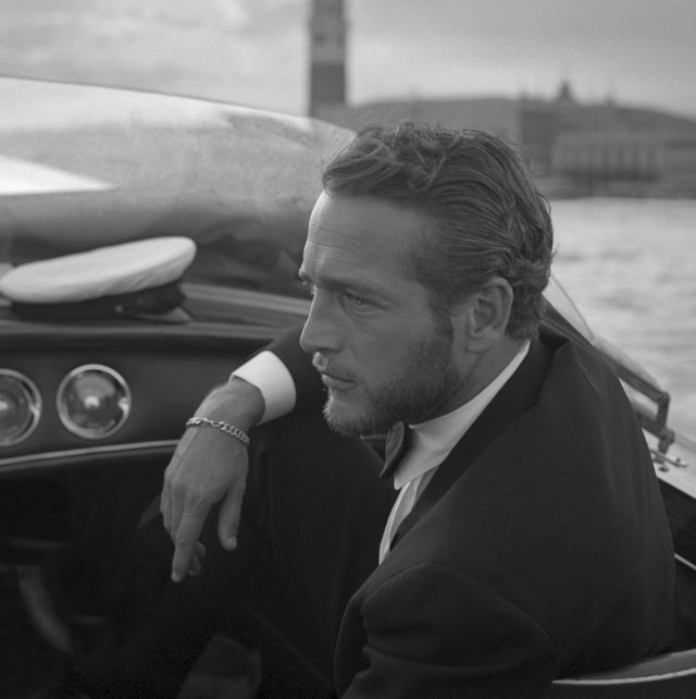 american actor paul newman, wearing a tuxedo and a bow tie, portrayed during a trip on a water taxi, a sailor cap on the dashboard, st mark square in the background, venice 1963 photo by archivio cameraphoto epochegetty images