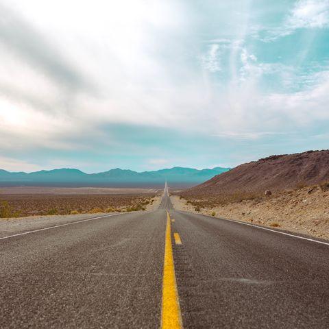 Road, Asphalt, Highway, Sky, Road trip, Yellow, Road surface, Mountainous landforms, Natural landscape, Natural environment,