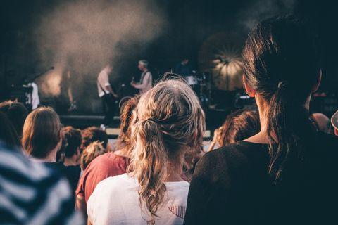 Rear View Of Crowd Enjoying Music Concert