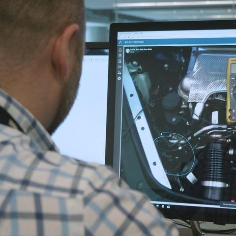a porsche technician uses augmented reality to diagnose a technical problem