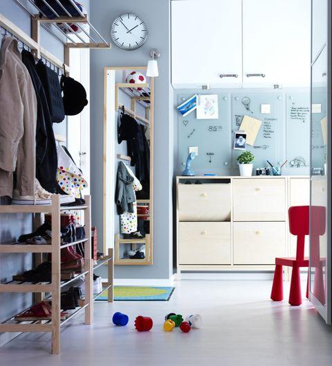 Room, Closet, Interior design, Clothes hanger, Furniture, Wardrobe, Shelf, Floor, Building, Door,